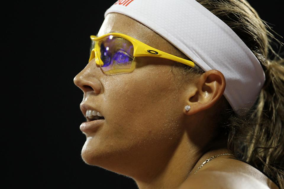 Lolo Jones of the US looks at the scoreboard after finishing third in the women's 100m hurdles at the IAAF Diamond League in Doha on May 6, 2011. (KARIM JAAFAR/AFP/Getty Images)