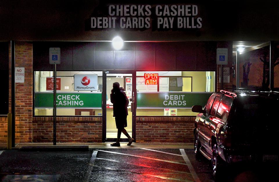 GAITHERSBURG, MD FEB 12: A customer leaves a payday loan store on Frederick Rd. in Gaithersburg, Maryland. The check cashing and payday loan services industry has thousands of branch offices all over the U.S. There are more payday lenders in the U.S. than McDonald's restaurants. There are various companies that offer payday loans for recurring expenses, unexpected expenses and paycheck cashing. The stores tend to be in urban and/or lower income areas. (Photo by Michael S. Williamson/The Washington Post via Getty Images)