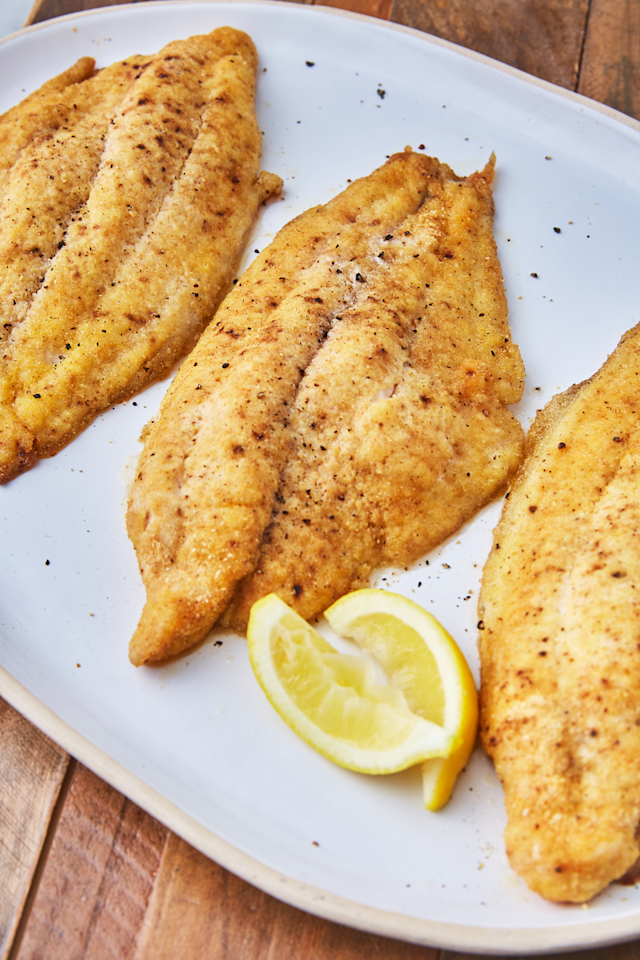 "<p>With a little lemon and cajun season = 😍</p><p>Get the recipe from <a href=""https://www.delish.com/cooking/recipe-ideas/a26595303/best-baked-catfish-recipe/"" target=""_blank"">Delish</a>.</p>"