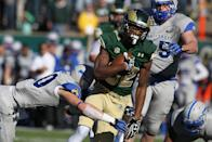Colorado State wide receiver Rashard Higgins, right, is tackled short of the goal line after catching a pass by Air Force defensive back Gavin McHenry in the first quarter of an NCAA football game in Fort Collins, Colo., on Saturday, Nov. 30, 2013. (AP Photo/David Zalubowski)