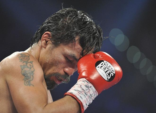 Manny Pacquiao of the Philippines concentrates during his  WBO welterweight title match  against Timothy Bradley of the US at the MGM Grand Arena on June 9, 2012 in Las Vegas, Nevada.  In what is being viewed as a highly controversial outcome, unbeaten Bradley ended Pacquiao's long unbeaten run with a split decision victory over the Filipino ring icon.     AFP PHOTO / JOE KLAMARJOE KLAMAR/AFP/GettyImages