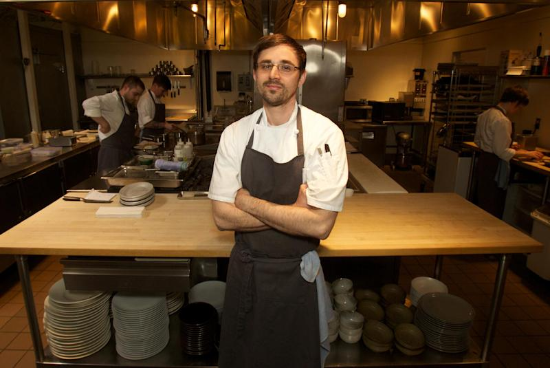 In this April 17, 2013 photo, Chef Justin Woodward stands in the kitchen of the restaurant Castagna in Portland, Ore. Far from the expectant gaze of major restaurant critics and the accompanying pressure to produce the Next Big Thing, the little-big city of Portland offers chefs a unique opportunity - the chance to experiment. (AP Photo/The Oregonian, Doug Beghtel)