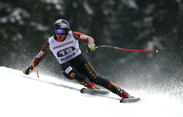 Canada's Erik Guay speeds on his way to take fouth place in an alpine ski, men's World Cup downhill. in Kvitfjell, Norway, Friday, Feb. 28 , 2014. (AP Photo/Alessandro Trovati)