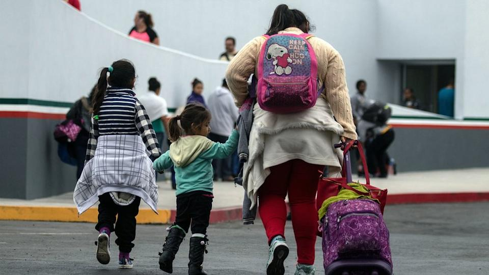 Migrants walk towards El Chaparral port of entry in Tijuana, Mexico, in the border with the US.