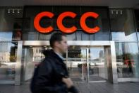 A man walks outside Polish shoe retailer CCC shop in Warsaw