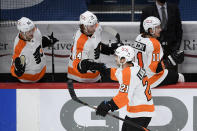 Philadelphia Flyers center Scott Laughton (21) celebrates his goal with the bench during the third period of the team's NHL hockey game against the Washington Capitals, Saturday, May 8, 2021, in Washington. The Capitals won 2-1 in overtime. (AP Photo/Nick Wass)
