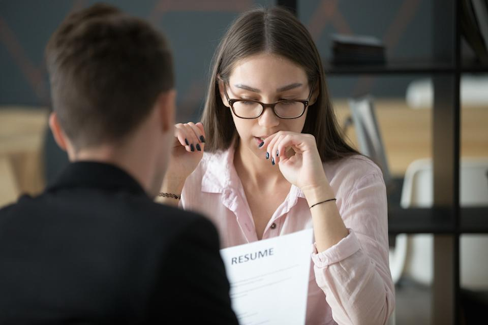woman biting nails during a job interview