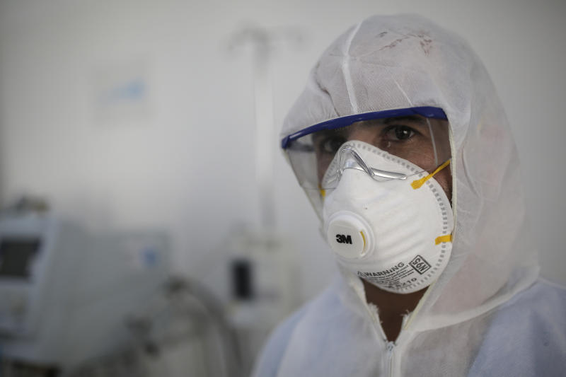 FILE - In this March 15, 2020 file photo, a medic sets up an isolation room in a coronavirus quarantine ward at a hospital in Sanaa, Yemen. Aid organizations are making an urgent plea for donations to shore up their operations in war-torn Yemen, saying they've already been forced to stop some of their work even as the coronavirus rips through the country. The calls for funds come ahead of a UN donor conference, hosted virtually by Saudi Arabia, scheduled to take place Tuesday, June 2, 2020. (AP Photo/Hani Mohammed, File)