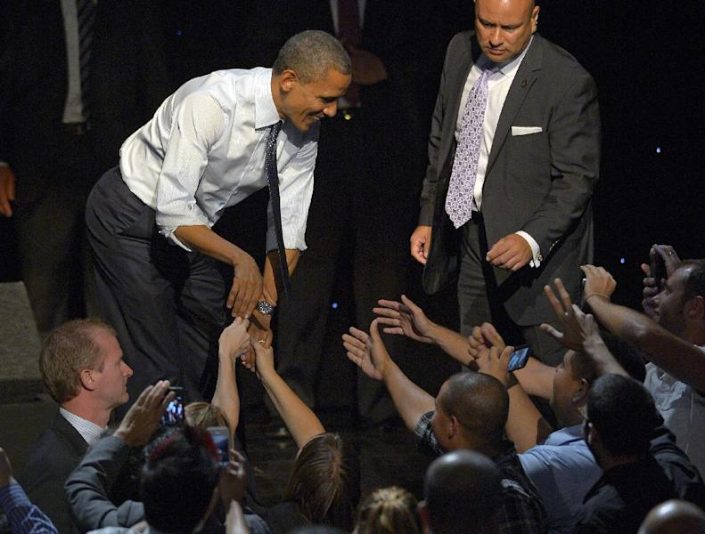 President Barack Obama shakes hands with supporters at a campaign event at the Nokia Theater, Sunday, Oct. 7, 2012, in Los Angeles. (AP Photo/Mark J. Terrill)