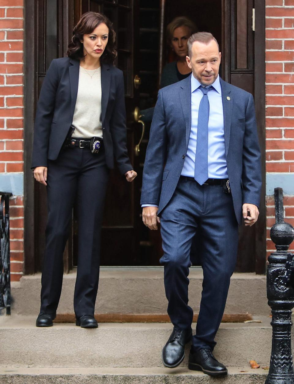 <p>Marisa Ramirez and Donnie Wahlberg are seen on the set of <i>Blue Bloods</i> on Monday in N.Y.C. </p>