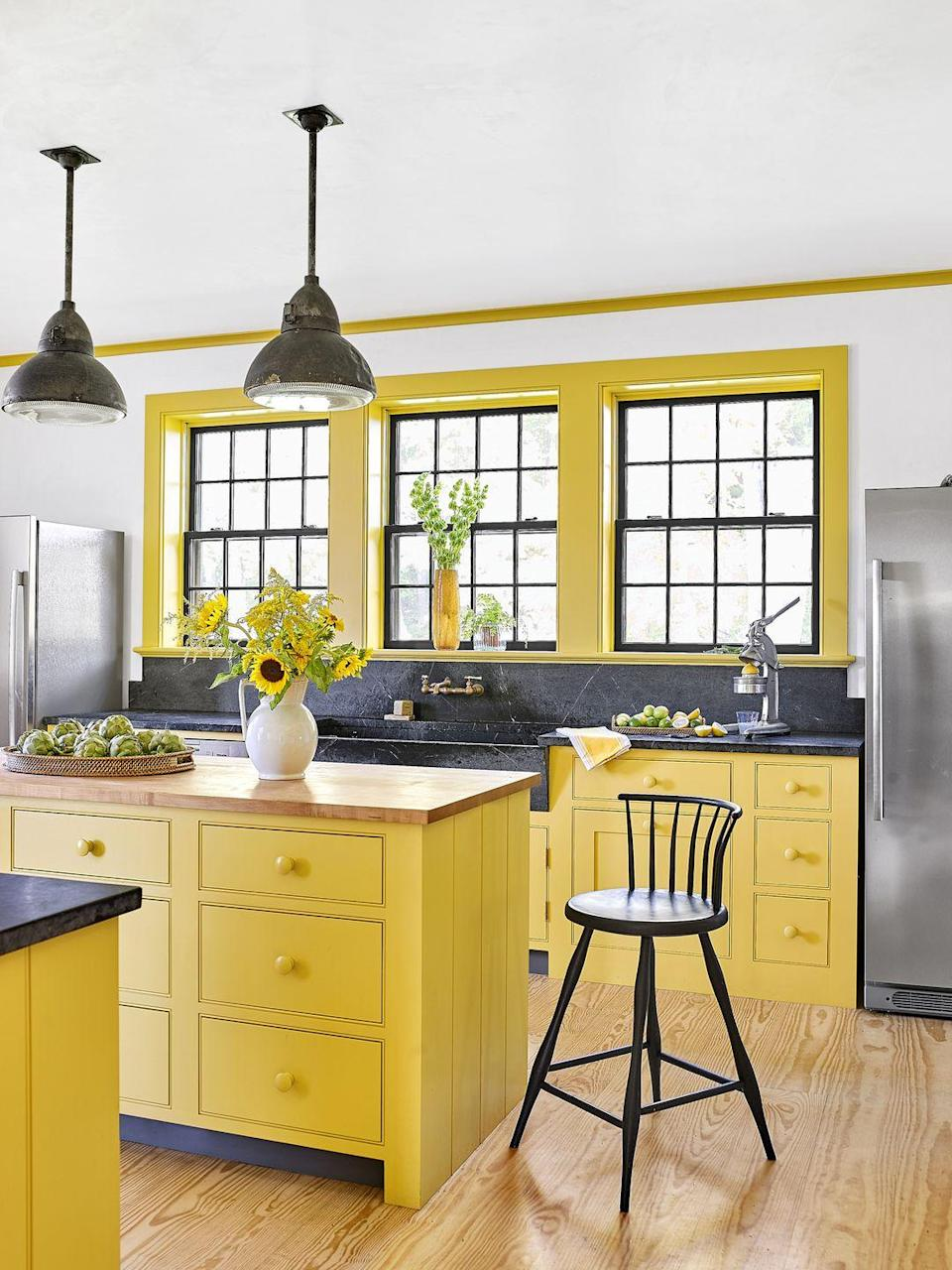 <p><strong>Paint Color: </strong>Pablo Honey by Backdrop Paint</p><p>All shades of yellow add a spring in your step, but we can't imagine a better way to start your day than in this cheerful kitchen that has cabinets painted in a saturated yellow. </p>
