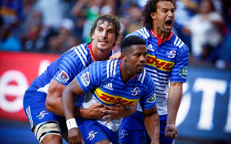 Trend-setter: Stormers wing Dillyn Leyds (right) set up a try with phenomenal offload against the Chiefs - EPA