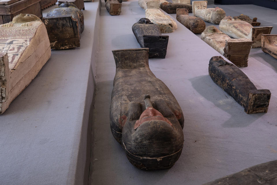 Ancient sarcophagus, discovered in a vast necropolis, are on display in Saqqara, Giza, Egypt, Saturday, Nov. 14, 2020. Egyptian antiquities officials on Saturday announced the discovery of at least 100 ancient coffins, some with mummies inside, and around 40 gilded statues south of Cairo. (AP Photo/Nariman El-Mofty)