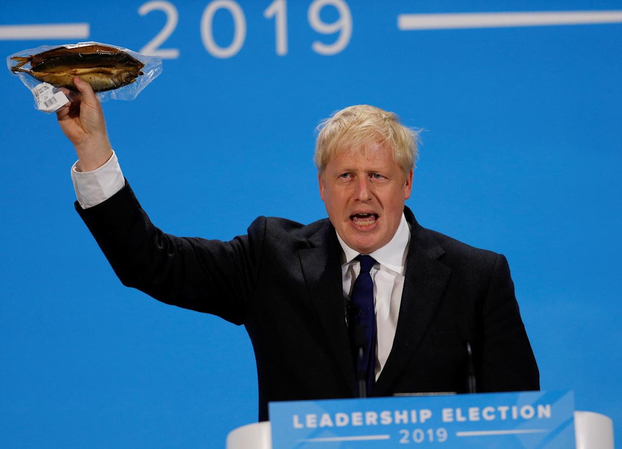 REFILE - ADDING INFORMATION Boris Johnson, a leadership candidate for Britain's Conservative Party, holds a plastic wrapped kipper fish during a hustings event in London, Britain July 17, 2019. REUTERS/Peter Nicholls     TPX IMAGES OF THE DAY