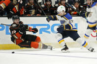 Anaheim Ducks right wing Jakob Silfverberg, left, falls as he battles for the puck with St. Louis Blues defenseman Torey Krug during the second period of an NHL hockey game Monday, March 1, 2021, in Anaheim, Calif. (AP Photo/Mark J. Terrill)