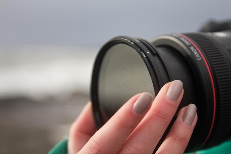 Detail of a photographer attaching an Neutral Density filter to the lens of a Canon EOS DSLR, taken on February 11, 2014. (Photo by Hollie Latham/PhotoPlus Magazine/Future via Getty Images)