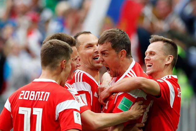 <p>Artem Dzyuba of Russia celebrates after scoring his sides third goal during the 2018 FIFA World Cup Russia group A match between Russia and Saudi Arabia at Luzhniki Stadium on June 14, 2018 in Moscow, Russia. (RUSSIA SOCCER FIFA WORLD CUP, Russia, Saudi Arabia, Moscow). </p>