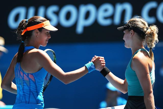 MELBOURNE, AUSTRALIA - JANUARY 21: Eugenie Bouchard of Canada shakes hands with Ana Ivanovic of Serbia after Bouchard won their quarterfinal match during day nine of the 2014 Australian Open at Melbourne Park on January 21, 2014 in Melbourne, Australia. (Photo by Mark Kolbe/Getty Images)