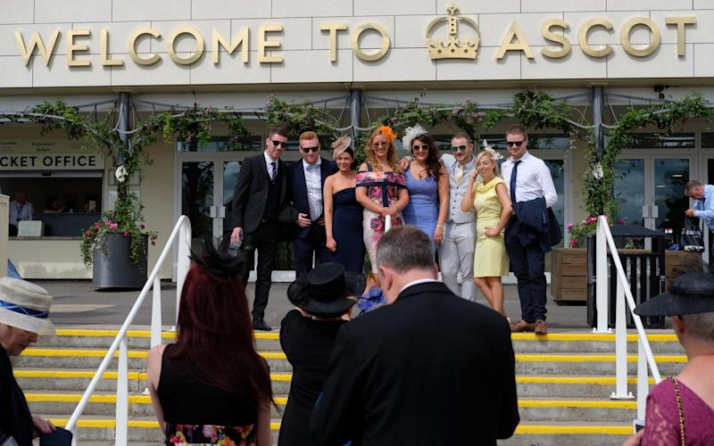uests pose on the steps during day 1 of Royal Ascot at Ascot Racecourse - GETTY IMAGES
