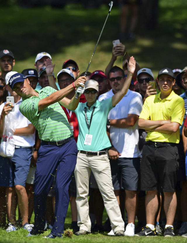 Justin Thomas watches his shot from the rough on the sixth hole during the final round of the Bridgestone Invitational golf tournament at Firestone Country Club, Sunday, Aug. 5, 2018, in Akron, Ohio. (AP Photo/David Dermer)