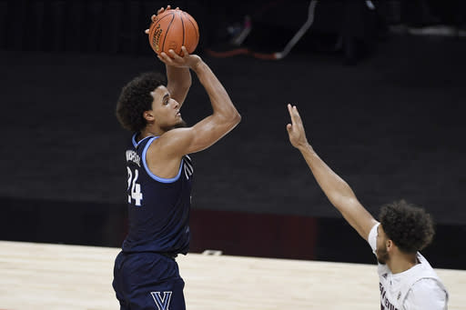 Villanova's Jeremiah Robinson-Earl shoots over Arizona State's Taeshon Cherry during the first half of an NCAA college basketball game Thursday, Nov. 26, 2020, in Uncasville, Conn. (AP Photo/Jessica Hill)