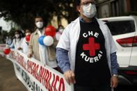 Doctors protest for better working conditions and resources to fight the COVID-19 pandemic in Asuncion, Paraguay, Friday, May 14, 2021. (AP Photo/Jorge Saenz)