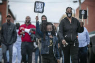 Six-year-old Diamond Wood marches through the streets of downtown Elizabeth City, N.C., Friday, April 23, 2021. Several days of protests followed the shooting death of Andrew Brown Jr. on Wednesday by sheriff's deputies serving drug-related search and arrest warrants. (Robert Willett/The News & Observer via AP)