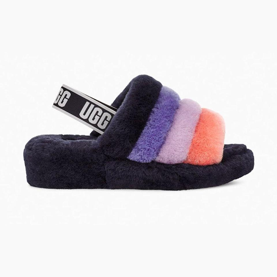 """<p>ugg.com</p><p><strong>$100.00</strong></p><p><a href=""""https://go.redirectingat.com?id=74968X1596630&url=https%3A%2F%2Fwww.ugg.com%2Fwomens-slippers%2Ffluff-yeah-slide%2F1095119.html%3Fdwvar_1095119_color%3DSNMT%26ranMID%3D43728%26ranEAID%3DTnL5HPStwNw%26ranSiteID%3DTnL5HPStwNw-P7B8hKbWM8pR.2VJcUJkSA&sref=https%3A%2F%2Fwww.menshealth.com%2Ftechnology-gear%2Fg34453261%2Fbest-gifts-for-sister%2F"""" rel=""""nofollow noopener"""" target=""""_blank"""" data-ylk=""""slk:BUY IT HERE"""" class=""""link rapid-noclick-resp"""">BUY IT HERE</a></p><p>Chances are she's spending the majority of her time at home this year (shocker). Under the new normal mindset, sales in slippers have skyrocketed and the Uggs you got her back in high school are making a major comeback in a different way. She'll love you forever if you buy her these.</p>"""