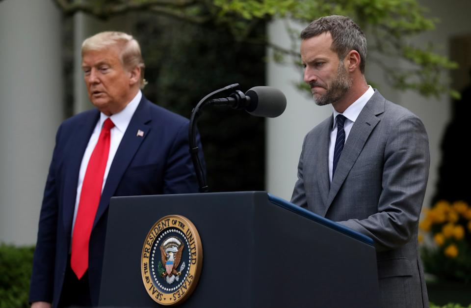 U.S. President Donald Trump listens as Adam Boehler, the CEO of the U.S. International Development Finance Corporation, addresses the daily coronavirus task force briefing in the Rose Garden at the White House in Washington, U.S., April 14, 2020. REUTERS/Leah Millis