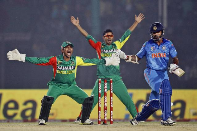Bangladesh's wicketkeeper Anamul Haque, left, and teammate Nasir Hossain appeal unsuccessfully for an LBW during the Asia Cup one-day international cricket tournament against India in Fatullah, near Dhaka, Bangladesh, Wednesday, Feb. 26, 2014. (AP Photo/A.M. Ahad)