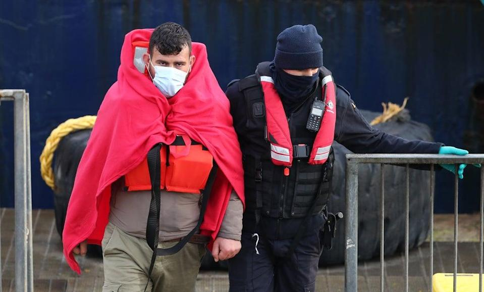 A group of people thought to be migrants are brought in to Dover (Gareth Fuller/PA) (PA Wire)
