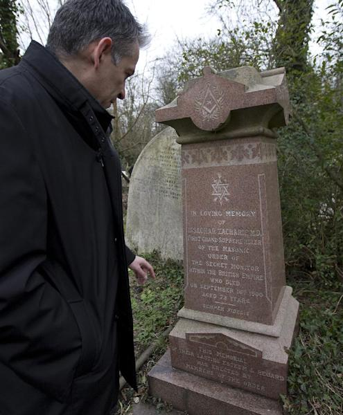 Ian Dungavell the CEO of Highgate Cemetery looks at the grave grave of Dr Isachar Zacharie which stands lopsided amongst other decaying tombs in Highgate Cemetery in north London Thursday, Feb. 28, 2013. Zacharie, best known as Abraham Lincoln's foot doctor, treating him and many members of the United States army during the US Civil War, died in London in 1900 and is buried in the same cemetery that also contains the remains of the philosopher Karl Marx . (AP Photo/Alastair Grant)