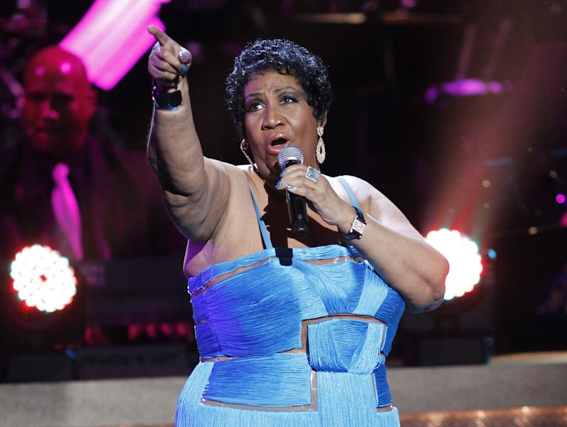 """FILE - This Jan. 14, 2012 file photo, shows singer Aretha Franklin performing during the BET Honors at the Warner Theatre in Washington. On Sunday, July 8, the Queen of Soul Aretha Franklin will be crowned with the Essence """"Power Award"""" for four decades of hits during the Essence Music Festival beginning Thursday. (AP Photo/Jose Luis Magana, file)"""