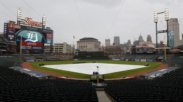 Rain falls on Comerica Park during a weather delay for a baseball game between the Cincinnati Reds and Detroit Tigers in Detroit, Saturday, Aug. 1, 2020. (AP Photo/Paul Sancya)