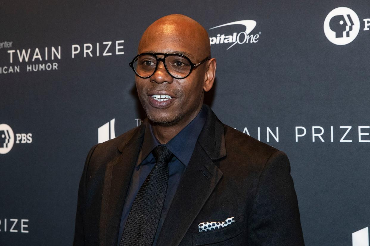 Comedian Dave Chappelle arrives at the Kennedy Center for the Mark Twain Award for American Humor on October 27, 2019 in Washington, D.C. - This years' award recipient is comedian Dave Chappelle. (Photo by Alex Edelman / AFP) (Photo by ALEX EDELMAN/AFP via Getty Images)