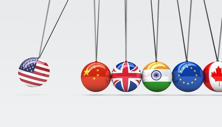Graphic showing international relationships represented as executive swinging toy.