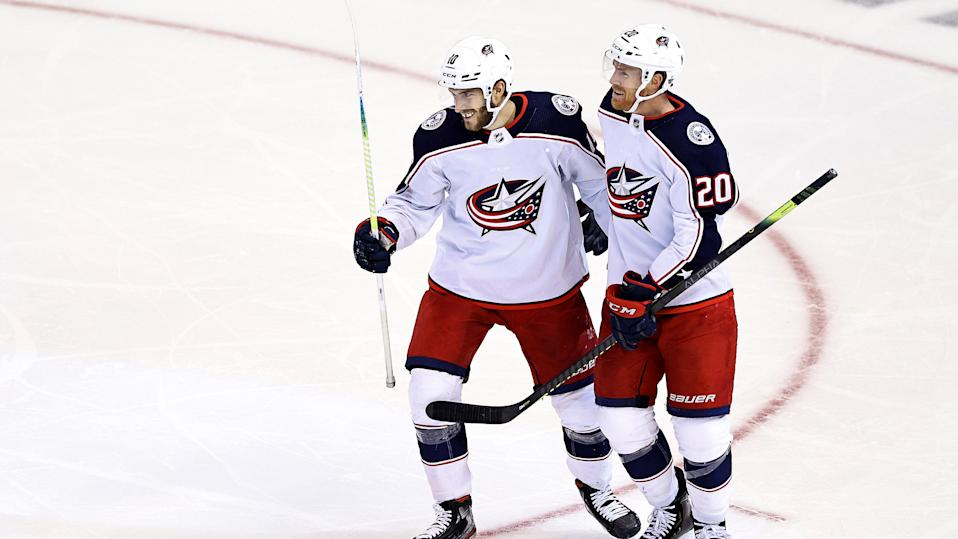 TORONTO, ONTARIO - AUGUST 13:  Alexander Wennberg #10 of the Columbus Blue Jackets is congratulated by his teammate, Riley Nash #20 after scoring a goal against the Tampa Bay Lightning during the third period in Game Two of the Eastern Conference First Round during the 2020 NHL Stanley Cup Playoffs at Scotiabank Arena on August 13, 2020 in Toronto, Ontario. (Photo by Elsa/Getty Images)