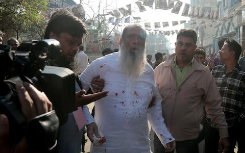 Salahuddin Ahmed, a candidate for the Bangladesh Nationalist Party, the largest single party in the opposition alliance, was stabbed in Dhaka as the election unfolded - Credit: Reuters