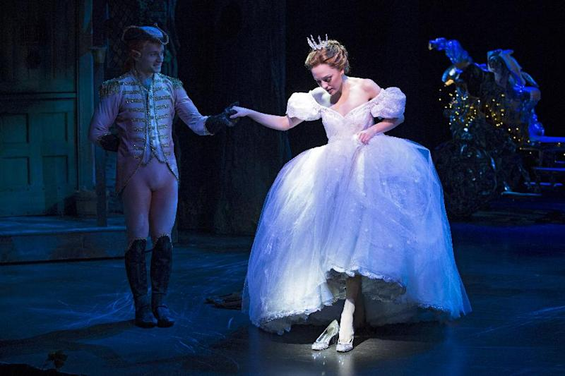"This theater image released by Sam Rudy Media Relations shows Laura Osnes as Cinderella, slipping on glass slippers designed by Stuart Weitzman, during a performance of ""Rodgers + Hammerstein's Cinderella on Broadway."" Weitzman knows how to make shoes that make a splash. For years, he made the ""million-dollar Oscar shoes,"" diamond-covered footwear that a celebrity would wear to the Academy Awards. (AP Photo/Sam Rudy Media Relations, Carol Rosegg)"