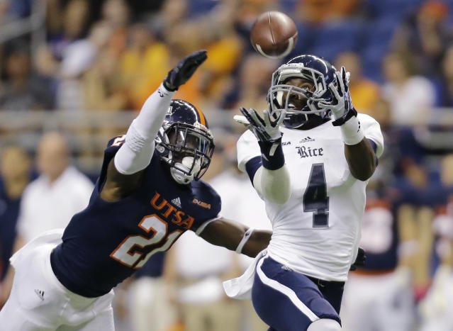 Rice's Dennis Parks (4) reaches for a pass as UTSA's Bennett Okotcha (21) defends during the first half of an NCAA college football game on Saturday, Oct. 12, 2013, in San Antonio. (AP Photo/Eric Gay)