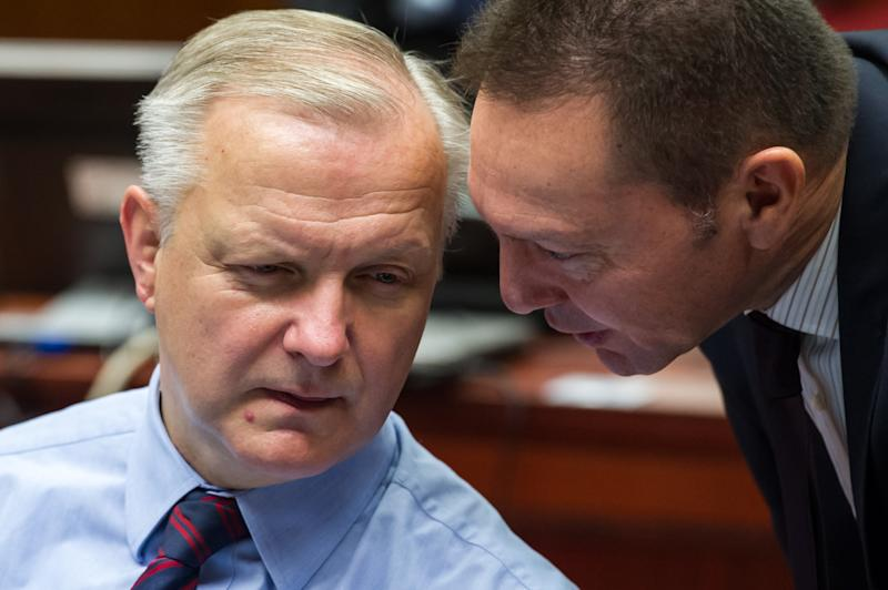 Greece's Finance Minister Ioannis Stournaras, right, talks with EU Commissioner for Economic and Monetary Affairs Olli Rehn at the start of an Ecofin meeting at the European Council building in Brussels, Tuesday Dec. 10, 2013. (AP Photo/Geert Vanden Wijngaert)
