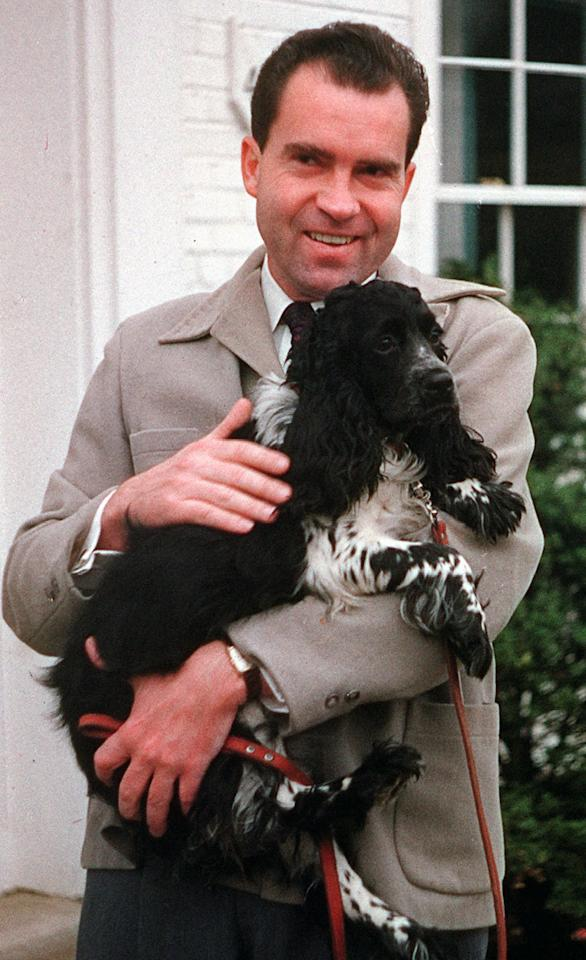 "Vice President Richard Nixon is seen with his dog ""Checkers,"" at his home in Spring Valley neighborhood of Washington, DC., on July 2, 1959.  (AP Photo)"