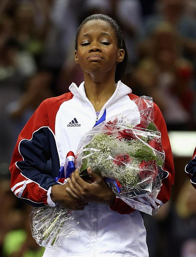 SAN JOSE, CA - JULY 01: Gabrielle Douglas reacts after being named to the US Gymnastics team going to the 2012 London Olympics at HP Pavilion on July 1, 2012 in San Jose, California. (Photo by Ezra Shaw/Getty Images)