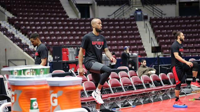 <p>Lorenzo Brown and Kaza Keane going through stretching exercises. 905's point guards have had a busy season, with Brown playing 14 games for the parent club while Keane travelled to Nassau, Bahamas in February to suit up for Team Canada at the FIBA World Cup qualifying. (Photo courtesy: Trung Ho) </p>