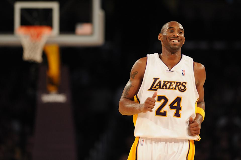 Kobe Bryant expertly crafted an iconic image that combined ruthlessness and charisma in a matter that reflected the love/hate relationship he had with the basketball public. He channeled a bitter 2008 Finals defeat into a joyous embrace of the difficult championship task ahead of him here at the start of the 2008-09 campaign. (Noah Graham/NBAE via Getty Images)