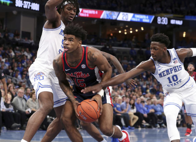 Memphis' Damion Baugh (10) reaches in as Mississippi's Luis Rodriguez (15) looks to the basket in the first half of an NCAA college basketball game Saturday, Nov. 23, 2019, in Memphis, Tenn. (AP Photo/Karen Pulfer Focht)