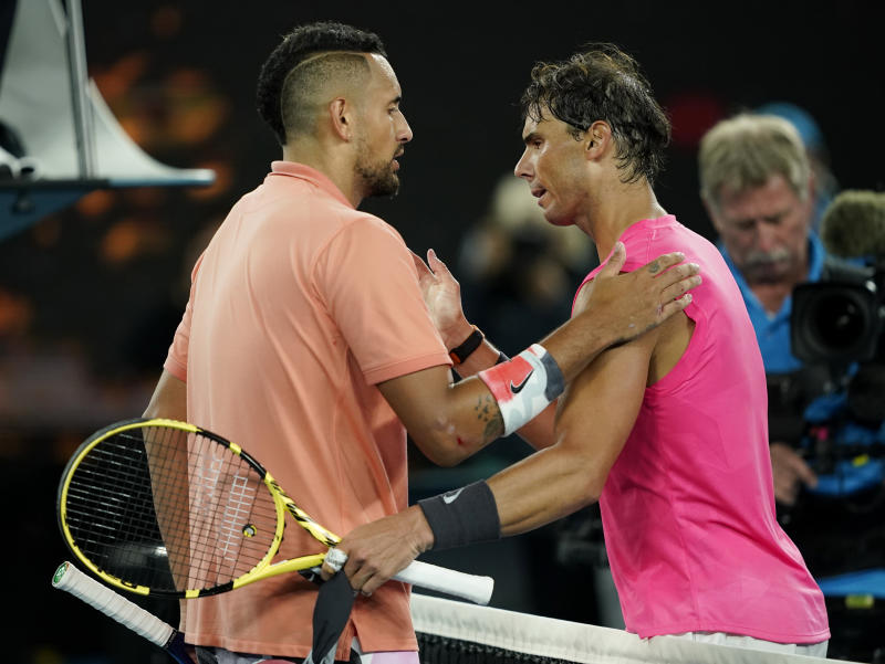 Spain's Rafael Nadal and Australia's Nick Kyrgios pat their shoulders after the match. (Reuters)