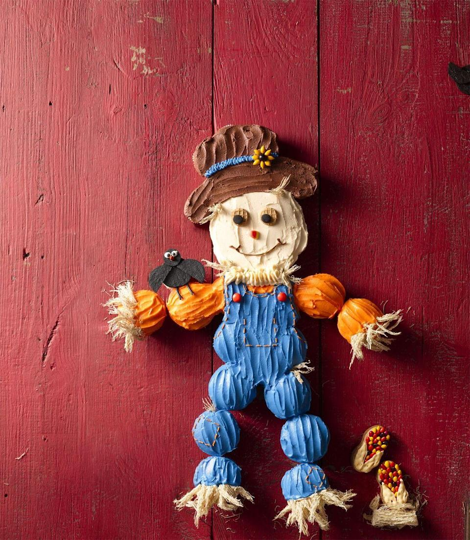 """<p>This cupcake scarecrow could also function as a decoration, until your guests start eating it.</p><p><strong><em><a href=""""https://www.womansday.com/food-recipes/food-drinks/recipes/a56159/cupcake-scarecrow-recipe/"""" rel=""""nofollow noopener"""" target=""""_blank"""" data-ylk=""""slk:Get the Cupcake Scarecrow recipe."""" class=""""link rapid-noclick-resp"""">Get the Cupcake Scarecrow recipe. </a></em></strong> </p>"""