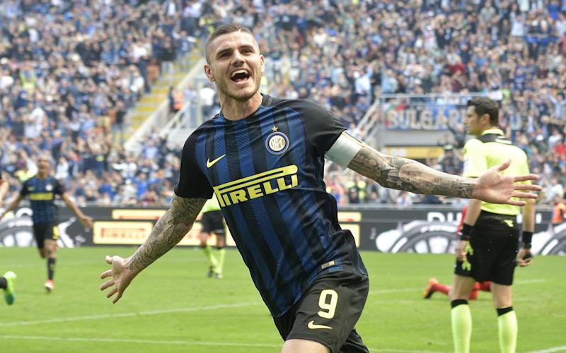 Inter's striker Mauro Icardi jubilates after scoring a goal during the Italian serie A soccer match between Fc Inter and Ac Milan - Credit: EPA