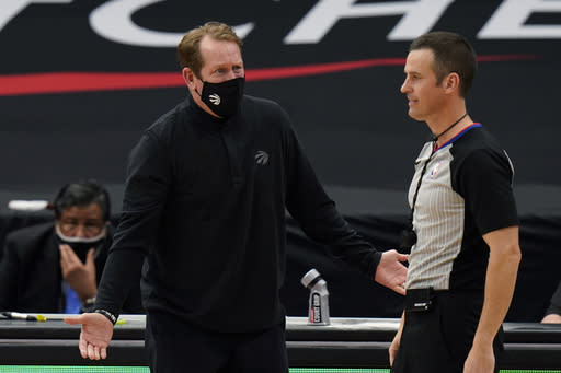 Toronto Raptors head coach Nick Nurse argues with referee Kevin Scott (24) during the second half of an NBA basketball game against the Miami Heat Wednesday, Jan. 20, 2021, in Tampa, Fla. (AP Photo/Chris O'Meara)